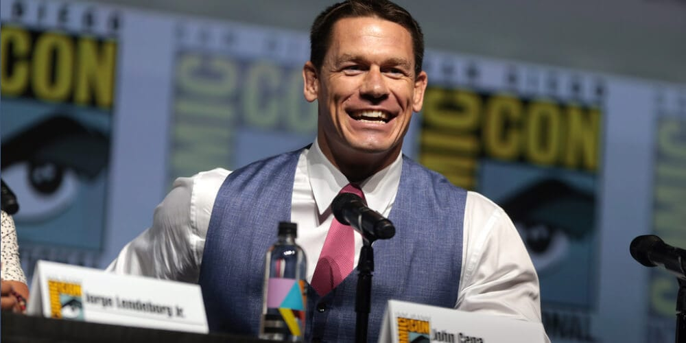 """An image of John Cena speaking at the 2018 San Diego Comic Con International, for """"Bumblebee"""", at the San Diego Convention Center in San Diego, California."""